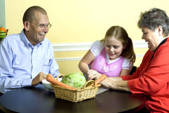 Chica joven con los abuelos Foto de archivo libre de regalías