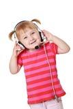 Chica joven con los auriculares Imagenes de archivo