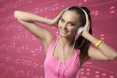 Chica joven con los auriculares Imagen de archivo