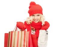Chica joven con los bolsos de compras Imágenes de archivo libres de regalías
