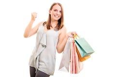 Chica joven con los bolsos de compras Fotografía de archivo libre de regalías