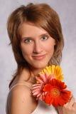 Chica joven con los gerberas Fotografía de archivo libre de regalías