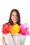 Chica joven con los giftbags Fotos de archivo libres de regalías