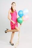 Chica joven con los globos Imagenes de archivo