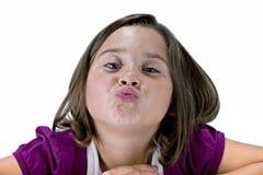 Chica joven con los labios puckered fotografía de archivo libre de regalías