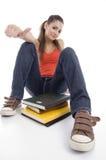 Chica joven con los libros Imagenes de archivo