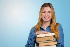 Chica joven con los libros Imagen de archivo