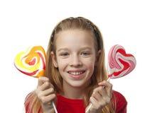Chica joven con los lollipops Foto de archivo