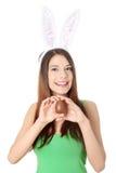 Chica joven con los oídos del conejito Imagenes de archivo