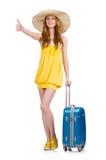 Chica joven con los pulgares del estuche de viaje para arriba Foto de archivo libre de regalías