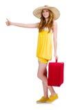 Chica joven con los pulgares del estuche de viaje para arriba aislados Imagen de archivo