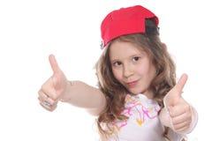 Chica joven con los pulgares para arriba Fotos de archivo libres de regalías