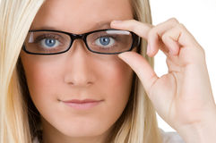 Chica joven con los vidrios Imagen de archivo libre de regalías