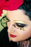 Chica joven con maquillaje. Fotos de archivo