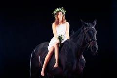 Chica joven con su caballo Fotografía de archivo libre de regalías