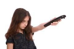 Chica joven con teledirigido Foto de archivo libre de regalías