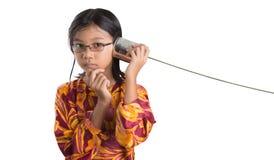 Chica joven con Tin Can Telephone VI Imagen de archivo libre de regalías