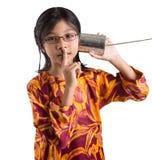 Chica joven con Tin Can Telephone VII Imagen de archivo
