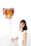 Chica joven con un globo Foto de archivo