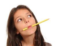 Chica joven con un lápiz Fotos de archivo