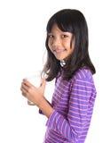 Chica joven con un vidrio de la leche V Imagen de archivo libre de regalías