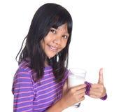 Chica joven con un vidrio de la leche VII Imágenes de archivo libres de regalías