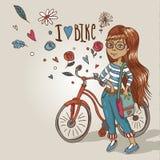 Chica joven con una bicicleta Imagen de archivo