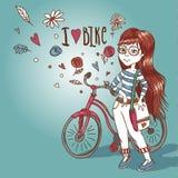 Chica joven con una bicicleta Imagen de archivo libre de regalías