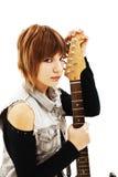 Chica joven con una guitarra Fotos de archivo