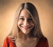 Chica joven con una sonrisa en su cara Imagen de archivo