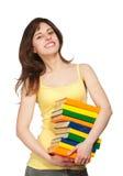 Chica joven de Smilling con los libros Fotografía de archivo