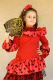 Chica joven del retrato con el ventilador fotografía de archivo libre de regalías