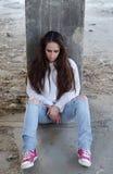 Chica joven deprimida perdida en pensamientos Fotografía de archivo libre de regalías