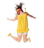 Chica joven emocionada que salta en blanco Foto de archivo libre de regalías