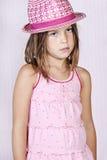 Chica joven en color de rosa imagenes de archivo