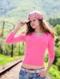 Chica joven en color de rosa Fotos de archivo