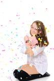 Chica joven en confeti Fotografía de archivo