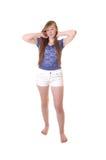 Chica joven en cortocircuitos. Foto de archivo