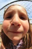 Chica joven en el circuito de carreras Imágenes de archivo libres de regalías