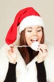 Chica joven en el sombrero de santa Imágenes de archivo libres de regalías