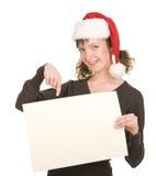 Chica joven en el sombrero de Santa Fotos de archivo