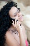 Chica joven en el teléfono Fotos de archivo libres de regalías