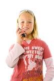 Chica joven en el teléfono Fotografía de archivo libre de regalías