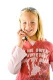 Chica joven en el teléfono Imágenes de archivo libres de regalías