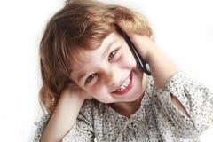 Chica joven en el teléfono celular Fotografía de archivo libre de regalías
