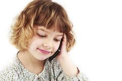Chica joven en el teléfono celular Fotos de archivo