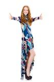 Chica joven en el vestido largo que manosea con los dedos para arriba Imagen de archivo