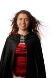 Chica joven en impermeable negro Fotografía de archivo libre de regalías
