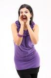 Chica joven en la acción de grito Fotos de archivo libres de regalías