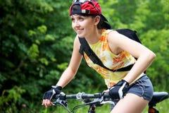 Chica joven en la bicicleta Imagen de archivo